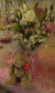 Flowers With A Teddy Bear
