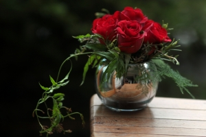 Red Roses In Mirrored Glass Bowl