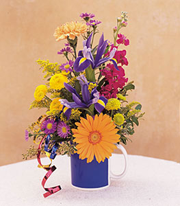 Cheerful Flowers In A Mug