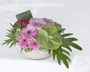 Clustered Flower Arrangement In Container
